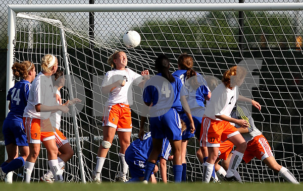Beck Diefenbach  -  bdiefenbach@daily-chronicle.com<br /> <br /> DeKalb's Cara Sisler (4) attempts to block a shot with her head during the second half of the game against Burlington Central at Rochelle Township High School in Rochelle, Ill., on Tuesday May 18, 2010. DeKalb defeated Burlington Central 4 to 2.