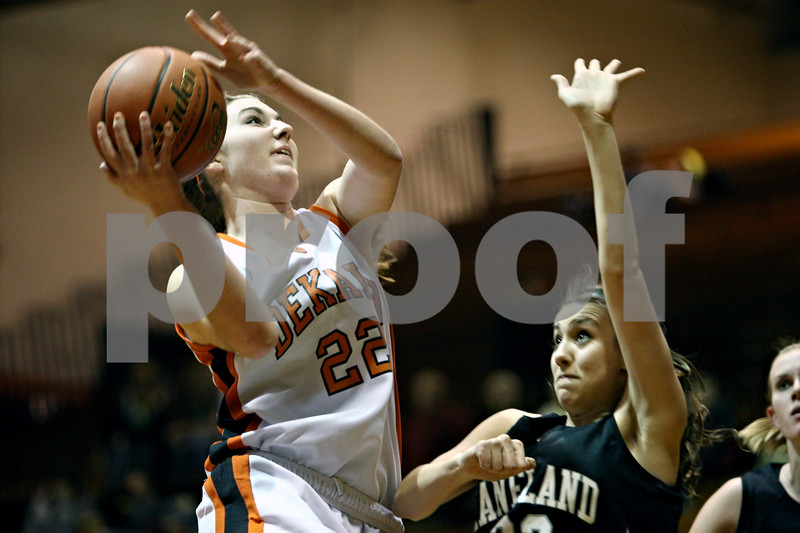Rob Winner – rwinner@daily-chronicle.com<br /> <br /> DeKalb's Emily Bemis puts up two over Kaneland forward Emma Bradford and draws the foul early in the first quarter in DeKalb on Tuesday night.
