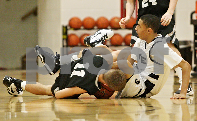 Rob Winner – rwinner@daily-chronicle.com<br /> <br /> Kaneland's Drew David and Hope's Jalen James struggle for a ball during the fourth quarter in Sycamore on Tuesday night. Hope went on to defeat Kaneland, 58-48.