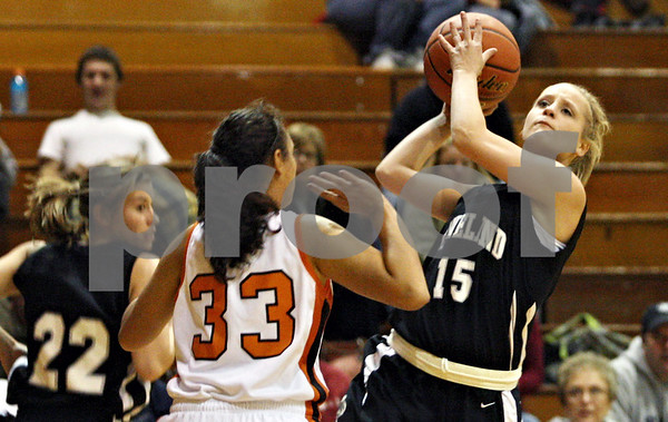 Rob Winner – rwinner@daily-chronicle.com<br /> <br /> Kaneland's Lexee Guerra puts up two in the second quarter in DeKalb on Tuesday night.