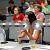 Beck Diefenbach  -  bdiefenbach@daily-chronicle.com<br /> <br /> Lorna Bemis, of Sycamore, asks a question during the Northern Illinois University football 101 women's clinic at Huskie Stadium in DeKalb, Ill., on Tuesday July 27, 2010.