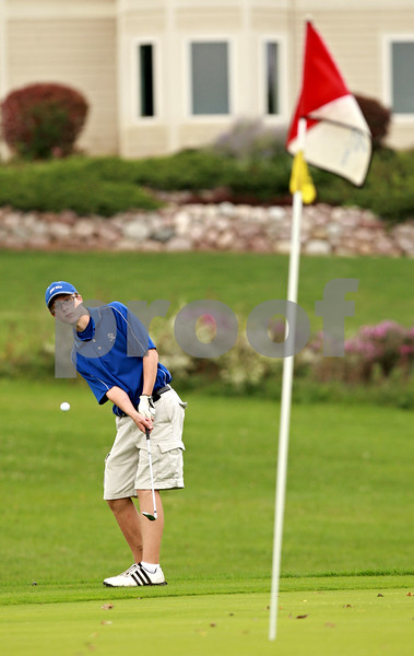 Beck Diefenbach – bdiefenbach@daily-chronicle.com<br /> <br /> Hinckley-Big Rock's Dillon Ford chips on to the 16th green during the Little 10 Conference Meet at the Hughes Creek Golf Course in Elburn, Ill., on Wednesday Sept. 22, 2010.