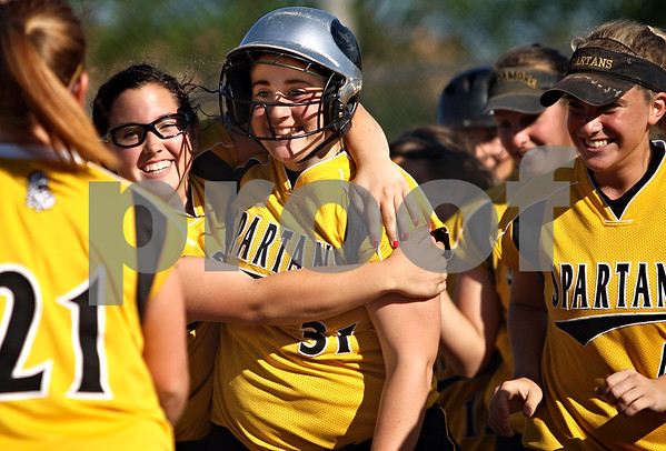 Beck Diefenbach  -  bdiefenbach@daily-chronicle.com<br /> <br /> Sycamore's Rachel Lesorgen (31, center) is congratulated by pitcher Abby Foulk (10, left) and the rest of her team after hitting a three-run home run during the fourth inning of the IHSA Class 2A Regional semi final game against DeKalb at Sycamore High School in Sycamore, Ill., on May 27, 2010.