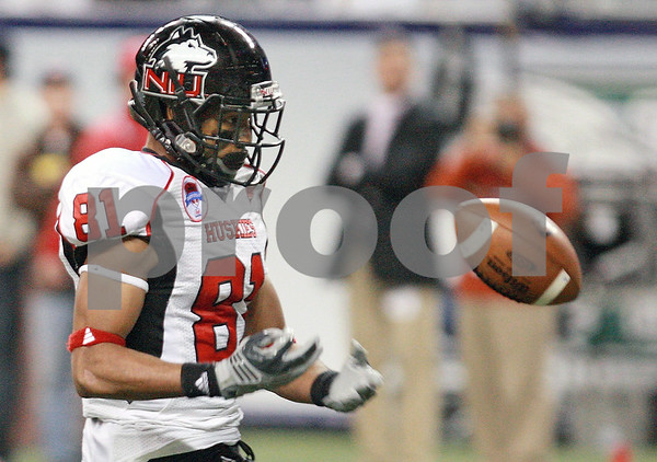 Kyle Bursaw – kbursaw@daily-chronicle.com<br /> <br /> Northern Illinois wide receiver Nathan Palmer (81) bobbles and loses a long pass in the first half of the MAC Championship game between the Northern Illinois Huskies game and the Miami (Ohio) Redhawks at Ford Field in Detroit, Mich. on Friday, Dec. 3, 2010.