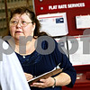 Beck Diefenbach  -  bdiefenbach@daily-chronicle.com<br /> <br /> DeKalb Postmaster Cynthia Schwartz greet a customer and conducts a survey in the lobby of the DeKalb Post Office on Tuesday July 20, 2010.