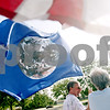 Beck Diefenbach - bdiefenbach@daily-chronicle.com<br /> <br /> Michael Day, of DeKalb, marches with a flag of the planet Earth during a ceremony remembering the U.S. bombings of Hiroshima on the campus of Northern Illinois University in DeKalb, Ill., on Friday Aug. 6, 2010.