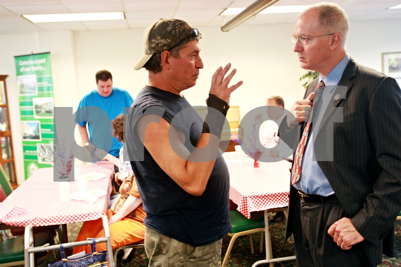 Beck Diefenbach - bdiefenbach@daily-chronicle.com<br /> <br /> U.S. congressman Bill Foster (right) speaks with Randy Guillotte, of DeKalb, during a dinner celebrating the completion of the water pipe replacement project at Golden Years Plaza in DeKalb, Ill., on Monday Aug. 23, 2010.