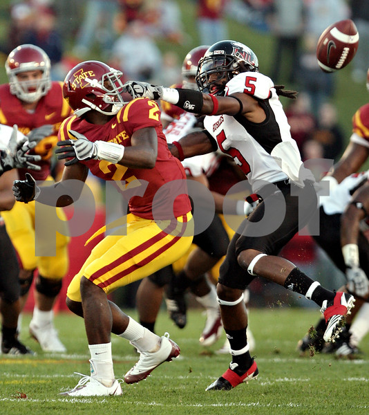 Beck Diefenbach  -  bdiefenbach@daily-chronicle.com<br /> <br /> Northern Illinois Chris Smith (5, right) grabs the face mask of Iowa State's Sedrick Johnson (2) during the first quarter of the game at Jack Trice Stadium on the campus of Iowa State University in Ames, Iowa, on Thursday Sept. 2, 2010.