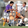 Beck Diefenbach - bdiefenbach@daily-chronicle.com<br /> <br /> Hononegah's Ettienne Montagner (14, left) and DeKalb's Jon Hagelstein (9) charge after the ball during the first half of the game at DeKalb High School in DeKalb, Ill., on Tuesday Aug. 24, 2010. DeKalb and Hononegah tied 1 to 1.