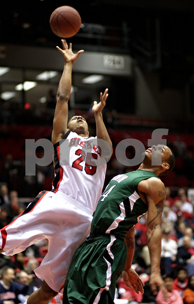 Beck Diefenbach  -  bdiefenbach@daily-chronicle.com<br /> <br /> Northern Illinois' Tony Nixon (25, left) shoots the ball over Ohio's Asown Sayles (44) during the first half of the game at NIU's Convocation Center in DeKalb, Ill., on Wednesday Jan. 27, 2010.