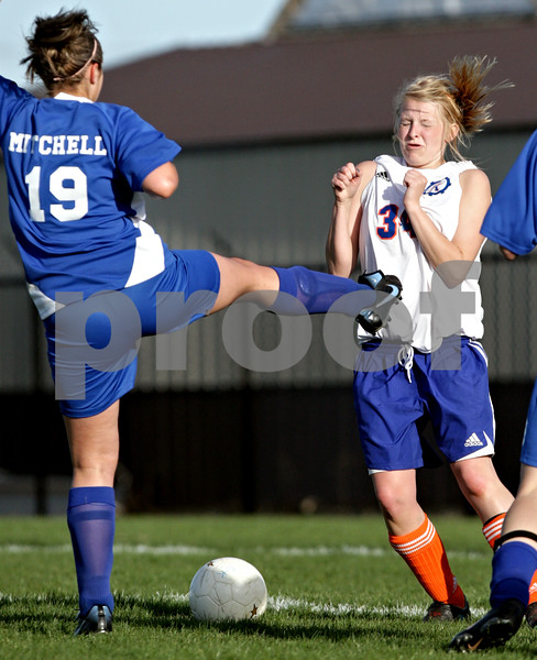 Beck Diefenbach  -  bdiefenbach@daily-chronicle.com<br /> <br /> Genoa-Kingston's Courtney Seisser (34, right) flinches as Hinckley-Big Rock's Kassandra Mitchell (19) misses the ball during the second half of the game at G-K in Genoa, Ill., on Monday April 26, 2010. H-BR defeated G-K 5 to 1.