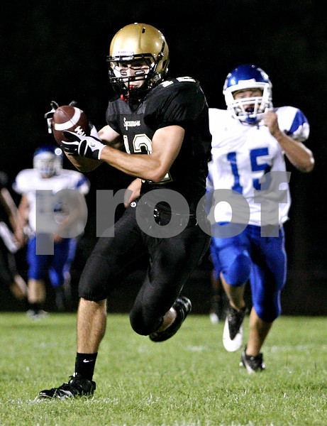 Rob Winner - rwinner@daily-chronicle.com<br /> <br /> Sycamore's Trevor Mathey hauls in a Ryan Bartels pass during the first quarter for a Spartans touchdown during their game against Burlington Central on Friday September 3, 2010 in Sycamore, Ill.