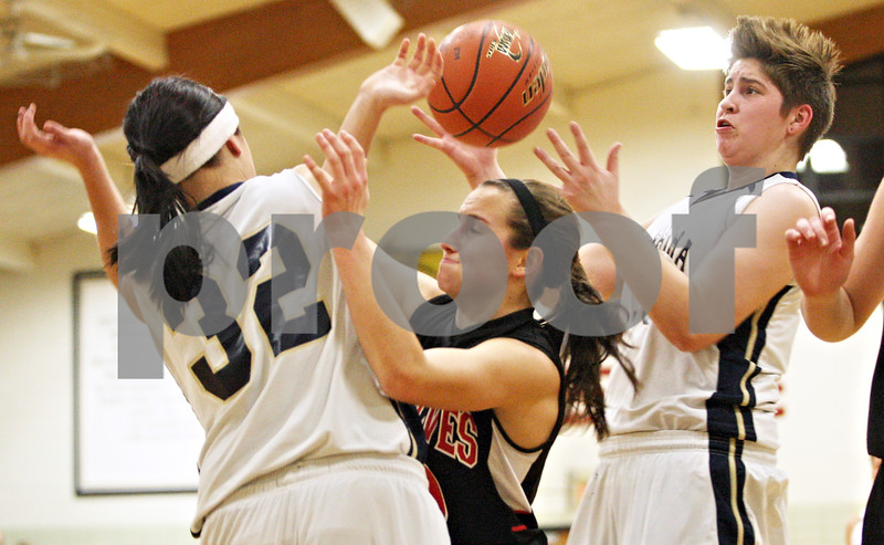 Rob Winner – rwinner@daily-chronicle.com<br /> <br /> (From left to right) Hiawatha's Anna Meyer, Indian Creek's Anna Stiker and Randi Maynard try to control a rebound underneath the Hawks' basket during the second quarter in Kirkland on Thursday night. Indian Creek went on to defeat Hiawatha, 43-40.