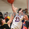 Kyle Bursaw – kbursaw@daily-chronicle.com<br /> <br /> Bryan Baumgarten shoots over the defense of Harvard's Matt Smith in the second quarter of the game at Genoa-Kingston High School on Tuesday, Dec. 07, 2010.