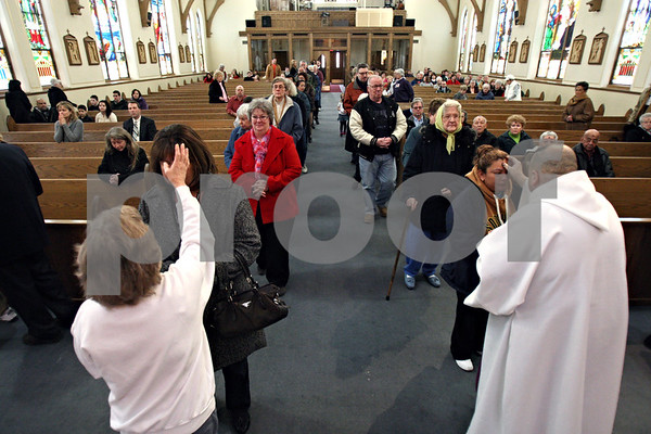 Rob Winner – rwinner@daily-chronicle.com<br /> For the beginning of Lent, members of St. Mary Parish in DeKalb, Ill. receive ash crosses on their foreheads on Wednesday February 17, 2010.