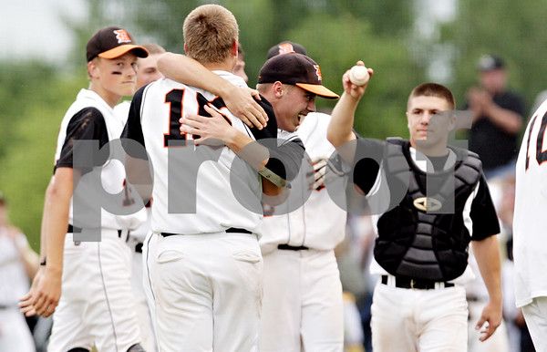 Rob Winner – rwinner@daily-chronicle.com<br /> <br /> DeKalb pitcher Ben Dallesasse (15) is hugged by Kevin Sullivan as catcher Jake Lemay brings over a game ball to Dallesasse after the IHSA Class 3A Augustana College Super-Sectional on Monday June 7, 2010. DeKalb defeated Galesburg, 8-4.