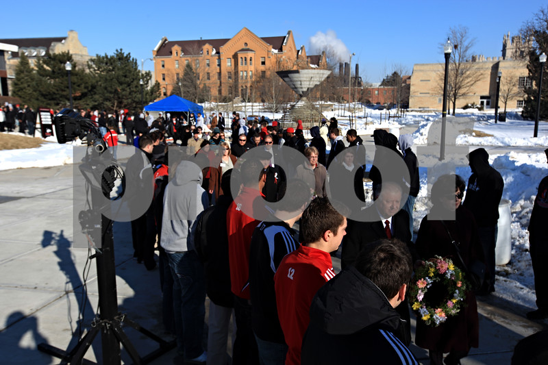 Beck Diefenbach – bdiefenbach@daily-chronicle.com<br /> <br /> Marking the two year anniversary of the shootings, Northern Illinois University President John Peters (lower right) leads the procession to the wreath laying at the memorial on NIU's campus in DeKalb, Ill., on Sunday Feb. 14, 2010.