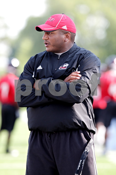 Beck Diefenbach - bdiefenbach@daily-chronicle.com<br /> <br /> Northern Illinois defensive line coach Jeff Phelps during the first practice at Huskie Stadium in DeKalb, Ill., on Thursday Aug. 5, 2010.