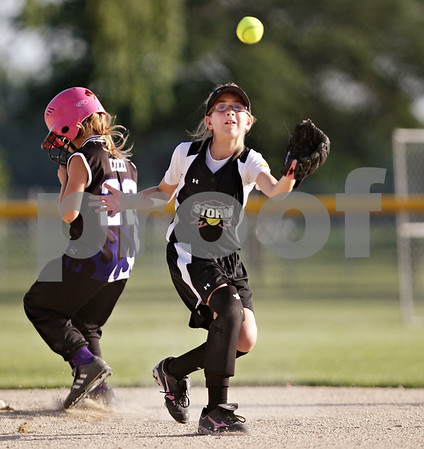 Beck Diefenbach  -  bdiefenbach@daily-chronicle.com<br /> <br /> Kishwuakee Valley Storm's Kate Majerus (11) catches a pop fly during the 10U game against the St. Charles Comets in the pool play portion of the Storm Dayz softball tournament at Sycamore Park in Sycamore, Ill., on Friday June 25, 2010.