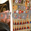 Kyle Bursaw – kbursaw@daily-chronicle.com<br /> <br /> Larry Franklin, the senior vice commander at VFW #2287, holds up a quilt with a complete collection of the Army World War II patches at the Bethany Health Care & Rehab Center, for residents to see. One resident and veteran, Calvin Henry, who declined to be photographed, collected all the patches, and gave them to the VFW to make the quilt.<br /> <br /> Thursday, Dec. 16, 2010.