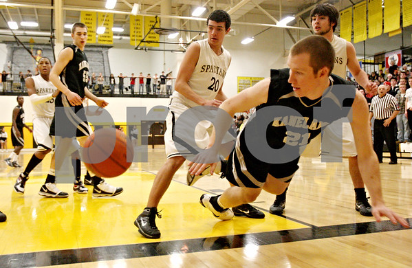 Rob Winner – rwinner@daily-chronicle.com<br /> Kaneland's Steve Colombe (21) is unable to save a loose ball under the Kaneland basket in the first quarter.