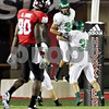 Rob Winner – rwinner@daily-chronicle.com<br /> <br /> North Dakota's Dominique Hawkins is lifted up by teammate Dan Hendrickson after intercepting a Chandler Harnish pass during the second quarter in DeKalb, Ill. on Saturday September 11, 2010.