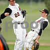 Beck Diefenbach  -  bdiefenbach@daily-chronicle.com<br /> <br /> DeKalb's Ben Dallesasse (15, left), Brian Sisler (22, center) and Kevin Sullivan (6, right) celebrate after defeating Geneva at DeKalb High School in DeKalb, Ill., on Wednesday May 12, 2010.