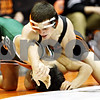 Rob Winner – rwinner@daily-chronicle.com<br /> <br /> DeKalb's Jake Jones (right) positions himself before pinning Glenbard West's Eh Doh Lwei during their 119-pound quarterfinal match at the Don Flavin Tournament at DeKalb on Wednesday, Dec. 29, 2010.
