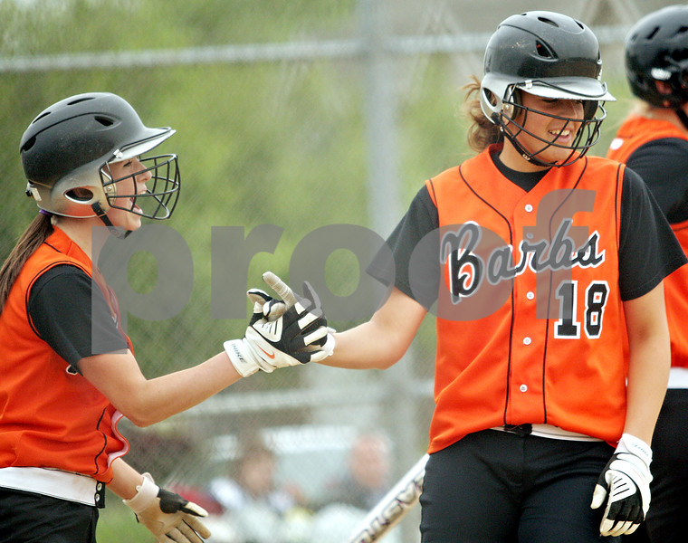 Beck Diefenbach  -  bdiefenbach@daily-chronicle.com<br /> <br /> DeKalb's Tia Lexa (5, left) congratulates Kelli Gerace (18, right) after scoring a run during the first inning of the game against Sycamore at Sycamore High School in Sycamore, Ill., on Monday May 10, 2010.