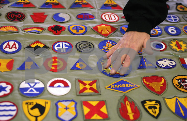 Kyle Bursaw – kbursaw@daily-chronicle.com<br /> <br /> Sandy Carey, a VFW #2287 volunteer, touches a quilt while explaining some of the patches on it. she constructed it out of a complete collection of the Army World War II patches. Carey was at the Bethany Health Care & Rehab center to present the quilt to veteran Calvin Henry, who declined to be photographed, but collected all the patches and gave them to the VFW to make the quilt.<br /> <br /> Thursday, Dec. 16, 2010.
