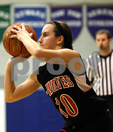 Rob Winner – rwinner@daily-chronicle.com<br /> Indian Creek's Anna Stiker sets herself before hitting a three in the second quarter during the Little 10 tournament in Hinckley, Ill. on Monday January 18, 2010.