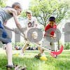 Rob Winner – rwinner@daily-chronicle.com<br /> <br /> Bobby Marshall (from left to right), 7, Luke Montavon, 16, and Francis Zaylik, 7, play field hockey on Thursday June 17, 2010 during Camp Maple Leaf at Hopkins Park in DeKalb, Ill.