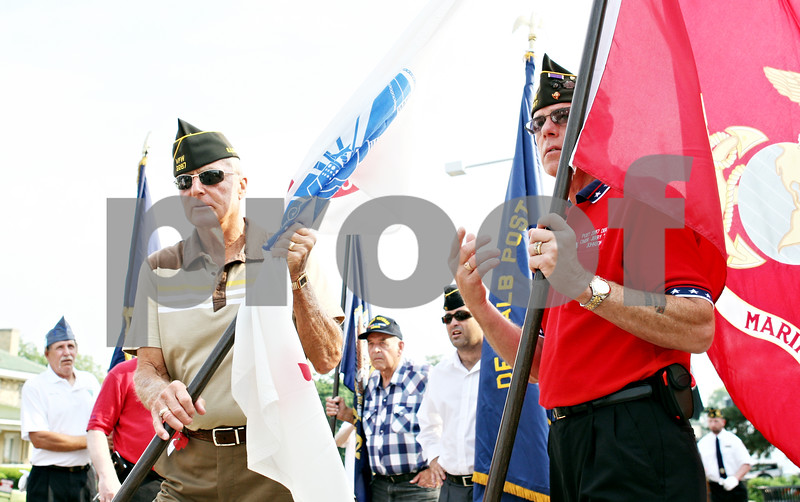 """Rob Winner – rwinner@daily-chronicle.com<br /> <br /> Jerry Busby and Jerry """"Jug"""" Johnson, both of VFW Post 2287 begin to line up for a Memorial Day ceremony at Memorial Park on Monday May 31, 2010 in DeKalb, Ill."""