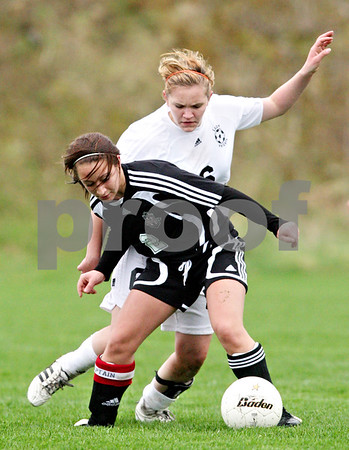 Beck Diefenbach  -  bdiefenbach@daily-chronicle.com<br /> <br /> Kaneland's Sam Wantuch (6, top) battles Indian Creek's Nina Yegoiants (2) for the ball during the second half of the game at Kaneland High School in Maple Park, Ill., on Wednesday April 7, 2010. Kaneland defeated Indian Creek 7 to 0.