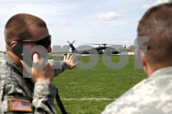 Rob Winner – rwinner@daily-chronicle.com<br /> <br /> One of three Black Hawk helicopters touches down in a lacrosse field just north of the Convocation Center in DeKalb, Ill. on Friday April 16, 2010.