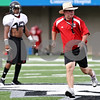 Rob Winner – rwinner@daily-chronicle.com<br /> <br /> NIU coach Jerry Kill leads by example as his team focused on special teams plays during practice on Friday August 13, 2010 at Huskie Stadium in DeKalb, Ill.
