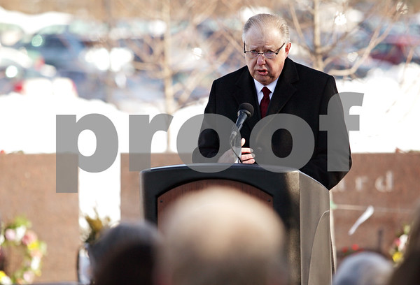 Beck Diefenbach – bdiefenbach@daily-chronicle.com<br /> <br /> Northern Illinois University President John Peters speaks to students and mourners during the wreath laying at the memorial on NIU's campus in DeKalb, Ill., on Sunday Feb. 14, 2010.