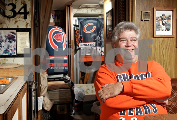 Beck Diefenbach  -  bdiefenbach@daily-chronicle.com<br /> <br /> Super fan Keith Rehberg poses in this Bears theme RV at his Sycamore, Ill., home on Tuesday Sept. 7, 2010.