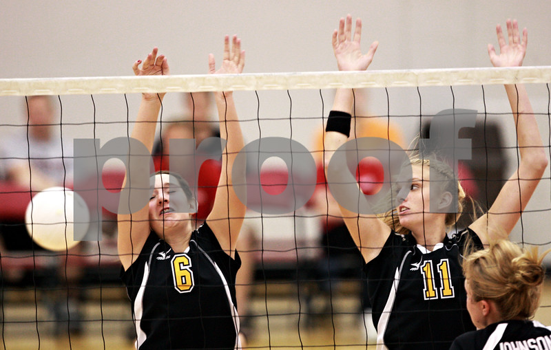 Beck Diefenbach – bdiefenbach@daily-chronicle.com<br /> <br /> Sycamore's Hannah Knox (6, left) and Envy McCoy (11) can't block the ball during the second game of the match against DeKalb at Victor E. Court in the Convocation Center on the campus of Northern Illinois University in DeKalb, Ill., on Tuesday Sept. 14, 2010. DeKalb defeated Sycamore 2 to 1.