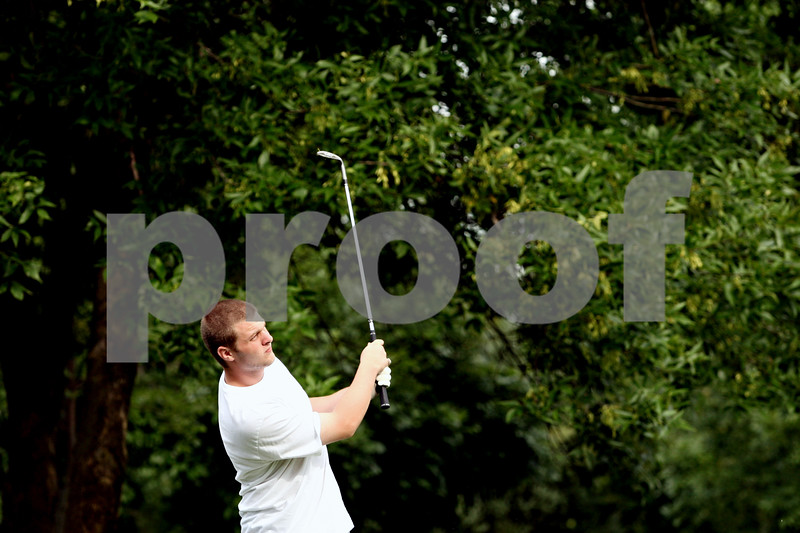 Rob Winner – rwinner@daily-chronicle.com<br /> <br /> Cody Schmitt, of the DeKalb golf team, practices his chipping at the Buena Vista Golf Course in DeKalb, Ill. on Tuesday August 17, 2010.