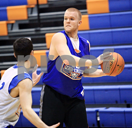 Beck Diefenbach  -  bdiefenbach@daily-chronicle.com<br /> <br /> Genoa-Kingston's Scott Suchy, right,  during practice at G-K High School in Genoa, Ill., on Monday Jan. 4, 2010.
