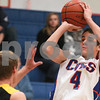 Kyle Bursaw – kbursaw@daily-chronicle.com<br /> <br /> Bret Lucca shoots over the defense of Harvard's William Gerrish in the first quarter of the game at Genoa-Kingston High School on Tuesday, Dec. 07, 2010.