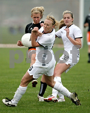 Rob Winner – rwinner@daily-chronicle.com<br /> <br /> DeKalb's Cara Sisler (left) kicks a ball that hits Sycamore's Lindsey Hemmerich during the first half of their game at Barbfest on Saturday April 24, 2010 in DeKalb, Ill.