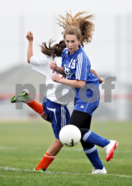 Beck Diefenbach  -  bdiefenbach@daily-chronicle.com<br /> <br /> Galena/Ricver Ridge Katelyn (19, front) collides with Genoa-Kingston's Rachael Harris (7, back) during the second half of the game at G-K High School in Genoa, Ill., on Tuesday May 11, 2010. G-K defeated Galena/River Ridge 8 to 1.