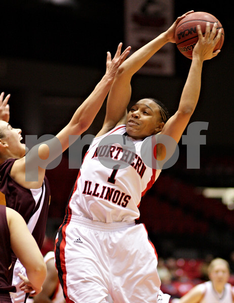 Beck Diefenbach  -  bdiefenbach@daily-chronicle.com<br /> <br /> Northern Illinois' Terriel Cannon (1, right) grabs a rebound during the first half of the game against Central Michigan at the NIU Convocation Center in DeKalb, Ill., on Wednesday Jan. 20, 2010