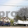 Beck Diefenbach  -  bdiefenbach@daily-chronicle.com<br /> <br /> Mike Thompson, of Lovetts Towing, inspects damage on a truck before he towed it in Pearl Street in DeKalb, Ill., on Tuesday April 20, 2010. The driver of the vehicle clipped the top of the truck under the railroad bridge on Pearl Street just south of West Lincoln Highway. Rail travel on the Pearl Street bridge was halted temporarily by Union Pacific Railroad until it was found to not be damaged.