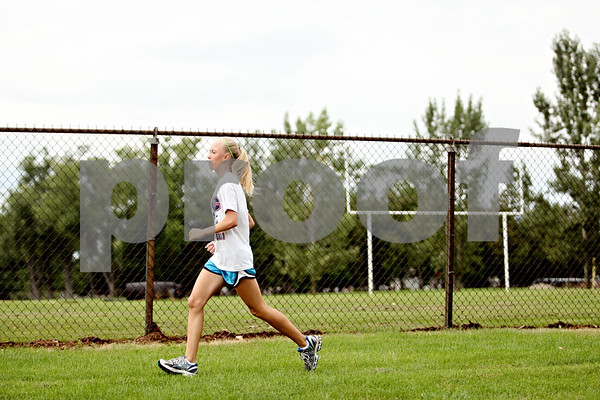 Rob Winner – rwinner@daily-chronicle.com<br /> <br /> Kelsey Schrader runs by the football field during practice in DeKalb, Ill. on Wednesday August 18, 2010.