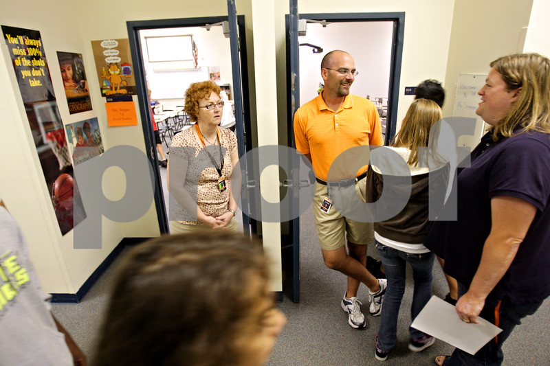 Beck Diefenbach – bdiefenbach@daily-chronicle.com<br /> <br /> To combat bullying outside the classroom, teachers like seventh grade math social studies teacher Kathi Shipper (left) and seventh grade math teacher Paul Schimbke (right) stand in the hallway during passing periods to be visible for children as they change classes at Clinton Rosette Middle School in DeKalb, Ill., on Wednesday Sept. 15, 2010.