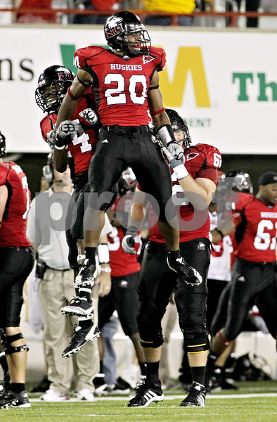 Rob Winner – rwinner@daily-chronicle.com<br /> <br /> Tommy Davis, of Northern Illinois, celebrates his fumble recovery after a kickoff during the fourth quarter in DeKalb, Ill. on Saturday September 11, 2010. Northern Illinois went on to defeat North Dakota, 23-17.