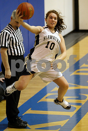 Rob Winner – rwinner@daily-chronicle.com<br /> Hiawatha's Cassie Lutz leaps to save a ball during the second half of the Hawks' game against Lamoille during the Little 10 tournament in Hinckley, Ill. on Monday January 18, 2010.